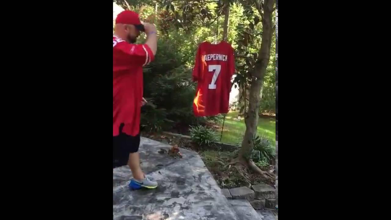 c3ac2a6ca 49ers Fan Burns Colin Kaepernick s Jersey to National Anthem - YouTube