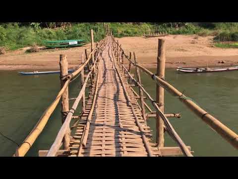 Crossing the bamboo bridge in Luang Prabang, Laos