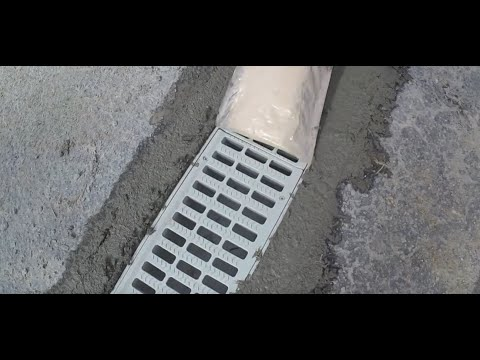 Installing A Grate Drain Or Channel Drain Across Driveway - Gate City Foundation Drainage