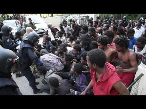 Migrants storm Spain