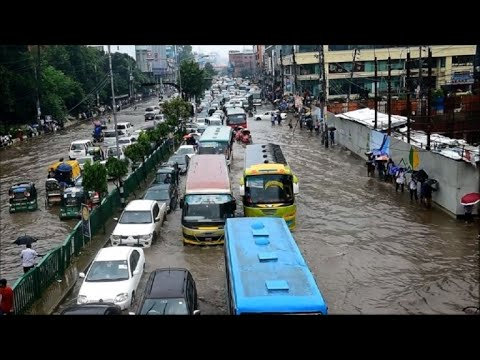Commuters stuck in floodwaters in Bangladesh's Dhaka