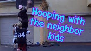 Professor hoops with neighborhood kids