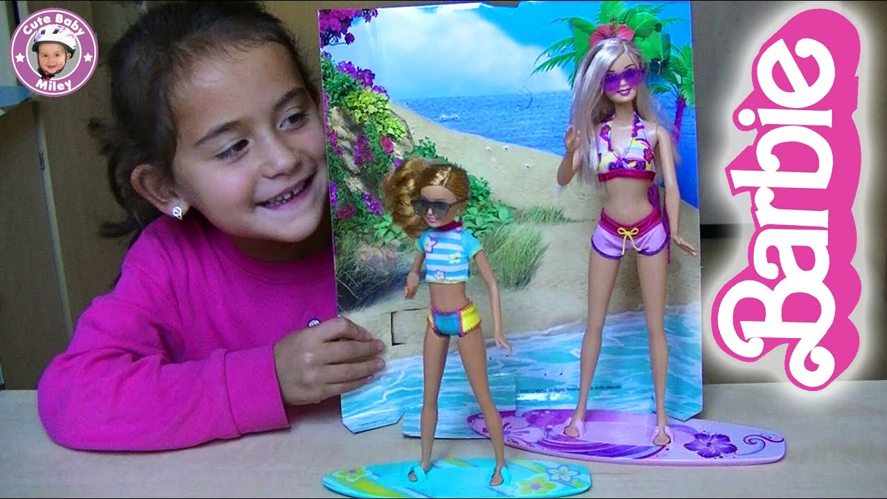 Barbie and stacie surfing on the beach unboxing life in the