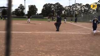 Brenda Milano sacrifices runner over to second in the first inning for Santa Catalina
