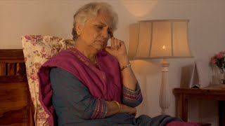 Stressed old Indian woman / lady having bad thoughts while sitting in her bedroom