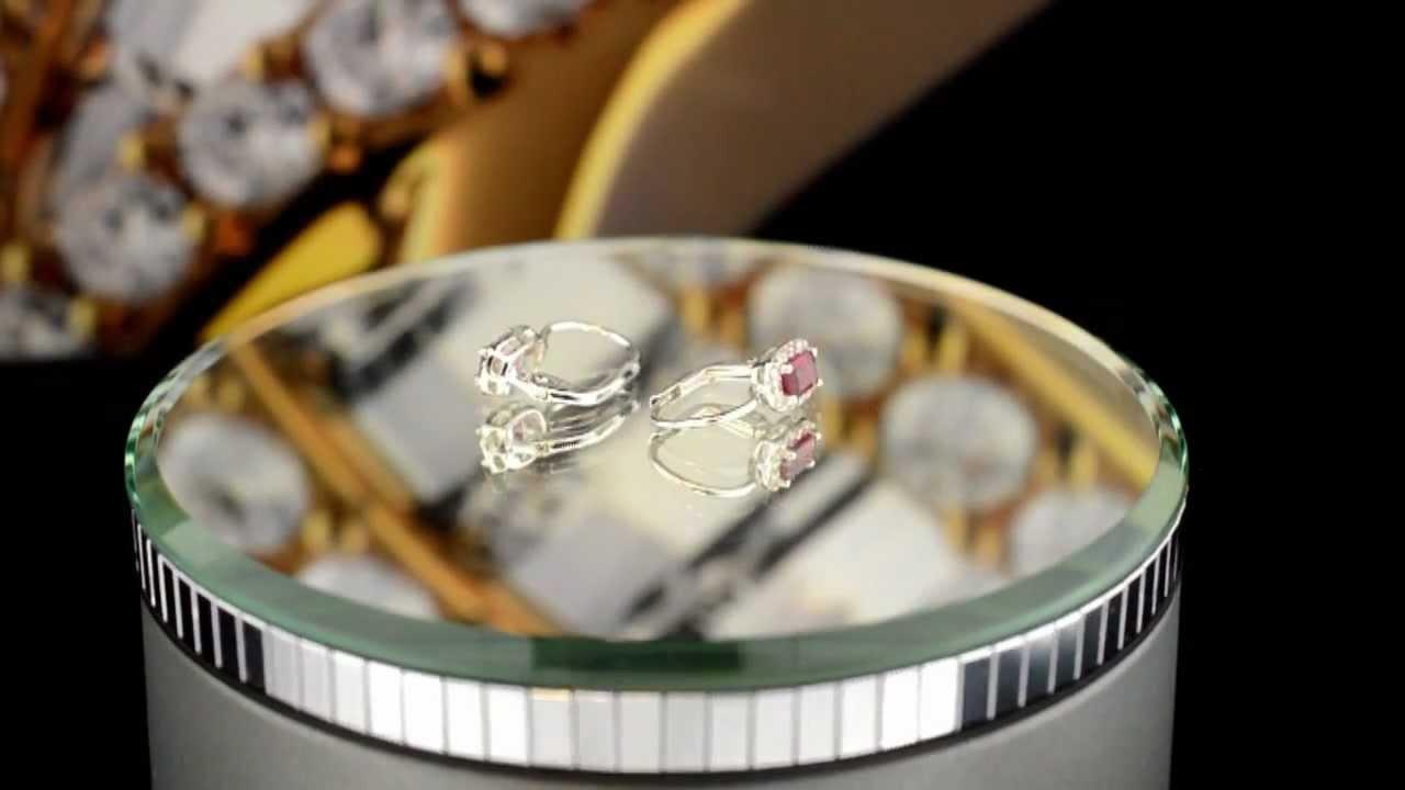 Nádherné náušnice z bílého zlata s rubínovým kamenem obklopeným ... bf1a63dd427