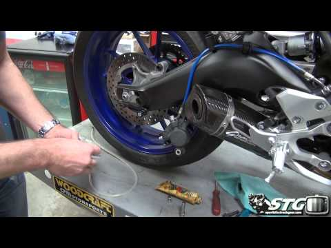 How To Replace Rear Brake Pads on a Yamaha FZ-09 from SportbikeTrackGear.com