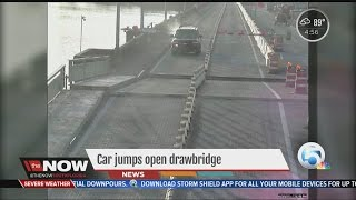 Car jumps open drawbridge