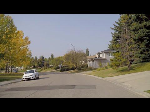 Driving in CALGARY Alberta Canada. University Area to Dalhousie Neighbourhood. Northwest of City.