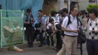 Media crowds at Japan bus stop scene of stabbing