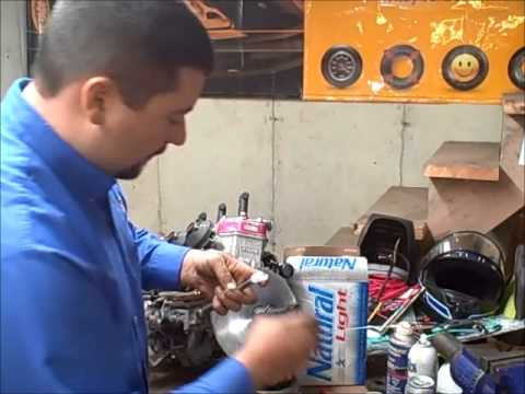How To Remove A Snowmobile Clutch, With A Natty Light - Maineyak