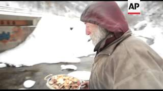 Bosnian man who lives in a cave endures severe winter weather
