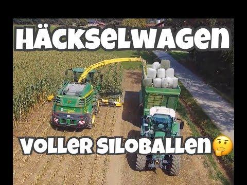 ein-häckselwagen-voller-silo-rundballen?