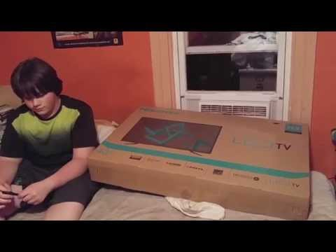 "William unboxes a 40"" tv he bought from the Walmart Black Friday Sale for $150"