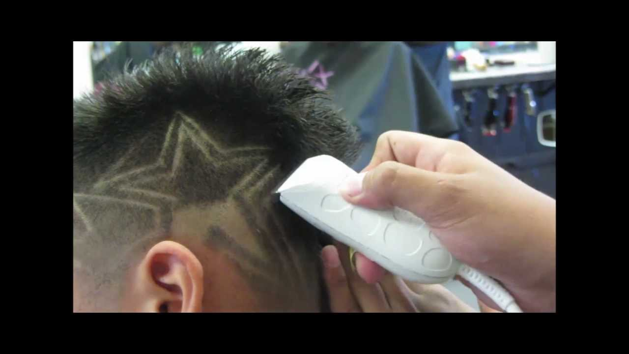 faded mohawk with star design haircut