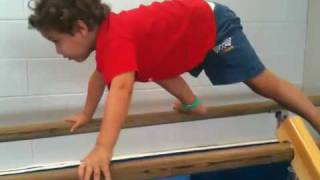 Charlie bear crawl in the parallel bars