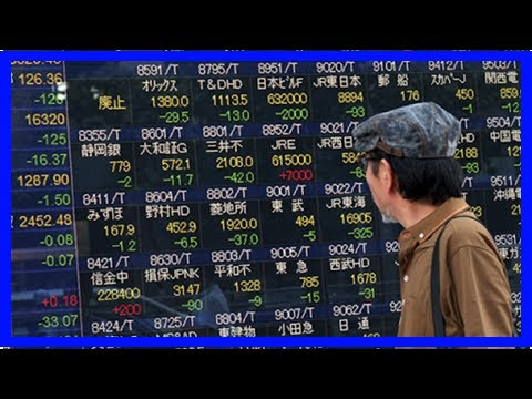 Nikkei posts solid rise despite strong yen; financials higher
