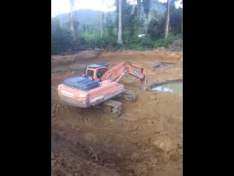 Stripping land for alluvial gold mining