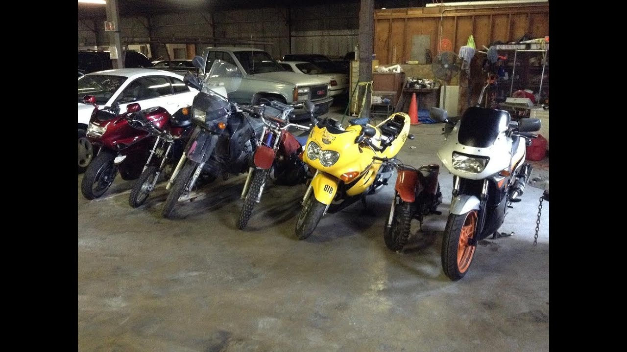 Bike Week at A&B in Oakland, CA - lineup of unclaimed police impounded  vehicles for August 20, 2014