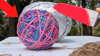 Glowing 1000 degree KNIFE VS Giant Rubber Band Ball