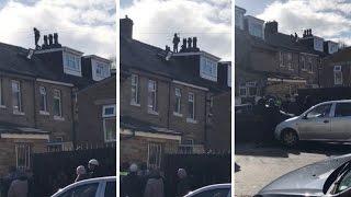 Suspected Burglars Making Getaway On Roof