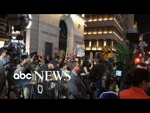 Trump greeted by protesters on his return to Trump Tower