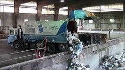 Garbage Trucks Dumping at the Transfer Station