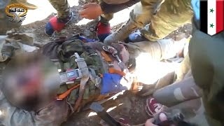 Russian pilot of Su-24 bomber appears dead in Syrian rebel video - TomoNews