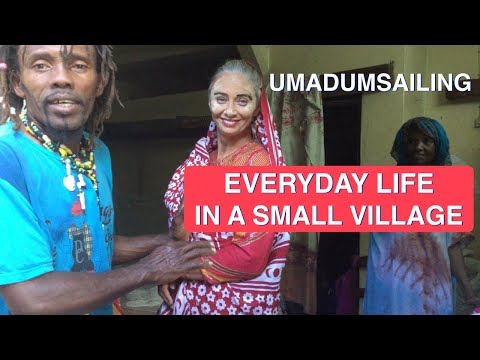 The Comoros. Everyday life in a small village. Traditional comorean  beauty mask and marriage dress.
