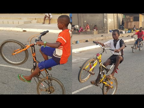 YOUNG BICYCLE RIDERS DISPLAYING THEIR SKILLS INSIDE ACCRA