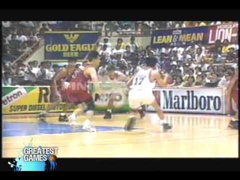Olsen Racela squeezes for the layup over Franz Pumaren (1994 PBA All-Filipino Cup Finals)