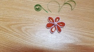 Make a beautiful paper flower with quilling art.
