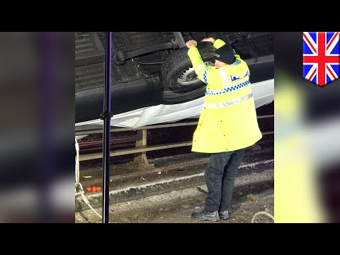 Super cop: Police officer stops car from falling off bridge using only his bare hands - TomoNews