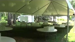 30x60 Wedding Tent by Teton Rental with Decorations, Lighting, Round Tables and White Chairs