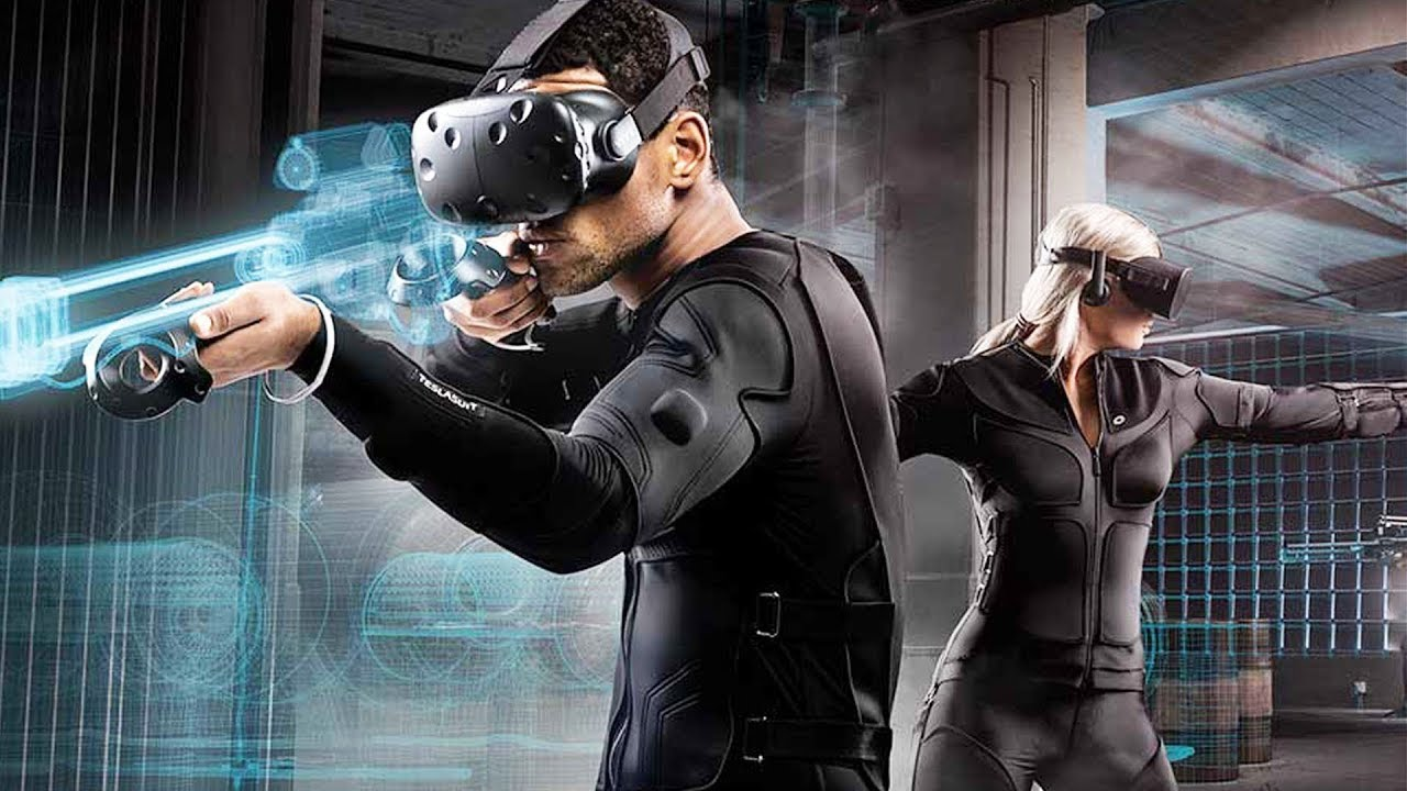 This VR Suit Lets You Feel The Game You're Playing - YouTube
