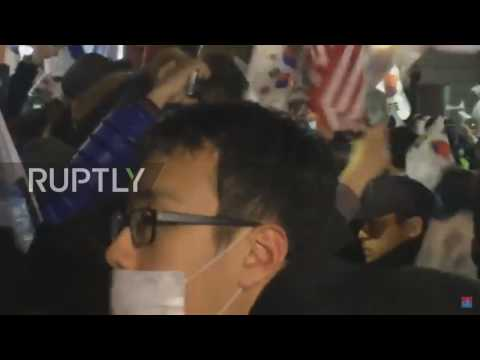 South Korea: Korean flags and Trump banners on show as Park leaves presidential house