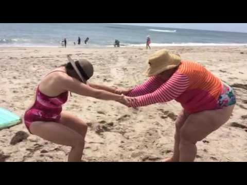 SPRINKLE YOGA at the beach with Trust Pose.
