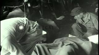 Wounded on stretchers being removed from a United States Army Air Forces C-54 Sky...HD Stock Footage