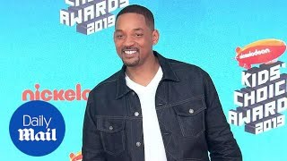 Will Smith keeps it casual on the orange carpet for the KCA's
