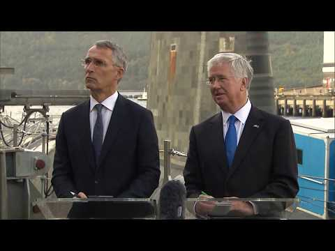 NATO Secretary General with the UK Minister of State for Def