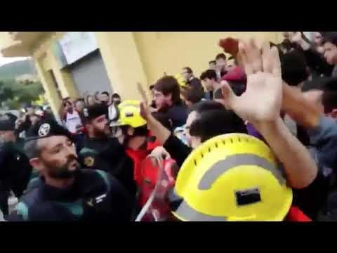 Catalan firefighters stand between Spanish police and voters