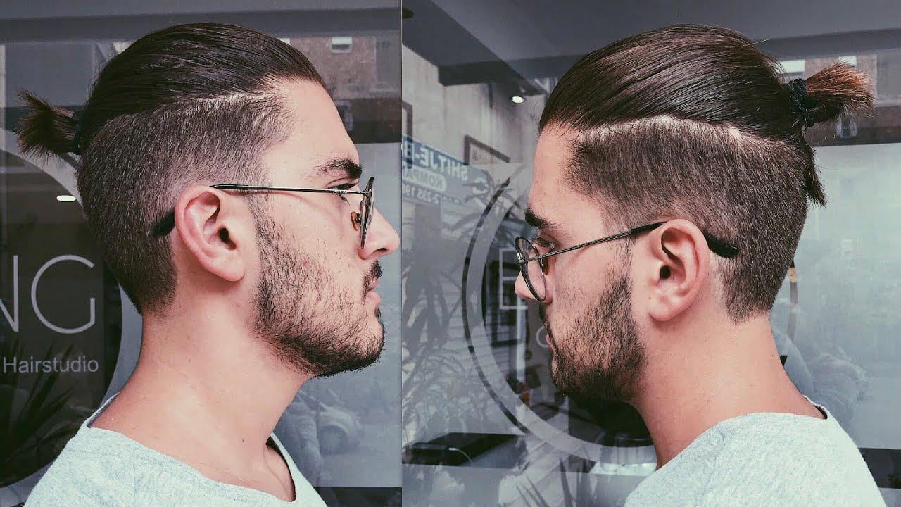 Disconnected Undercut Haircut With A Top Knotman Bun Mens Haircut
