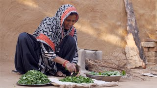 Sarson ka Saag - Indian woman cutting mustard leaf / sarson with a traditional iron cutter