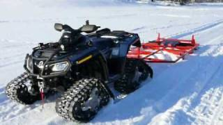 Trail groomer and skiing track