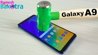 Beat and rub some tools on the display of SAMSUNG GALAXY A9 2018 fo...