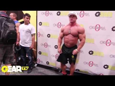 Bodybuilder Aaron Clark Flexing at 2013 Mr Olympia Expo No Shirt Posing