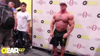 Bodybuilder Aaron Clark Flexing at 2013 Mr Olympia Expo No Shirt Posing
