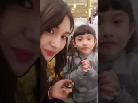 Somi with her family via Facebook Live