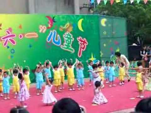 little girl dances at children's day