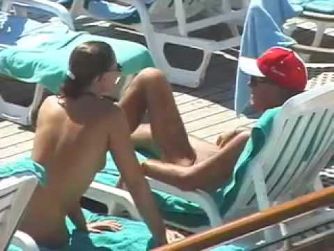 Nudist tanned on the boat